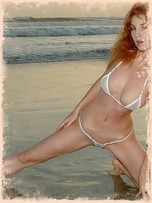 Stephanie on the beach in white