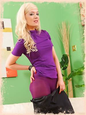 Faye X teases her way out of her tight top and black miniskirt and reveals her gorgeous body in purple lingerie and pantyhose.