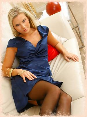 Blue satin short evening dress with black stockings and suspenders