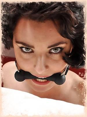 Slut writhes on the bed in bondage